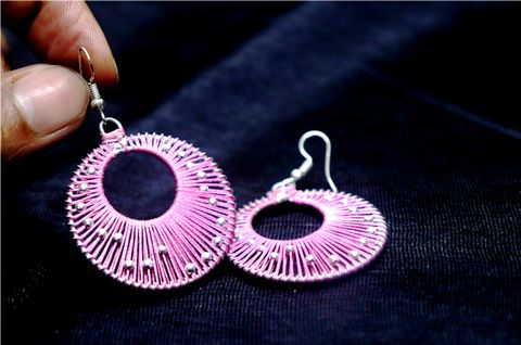 Buy these awesome pair of Earrings made of thread. High quality