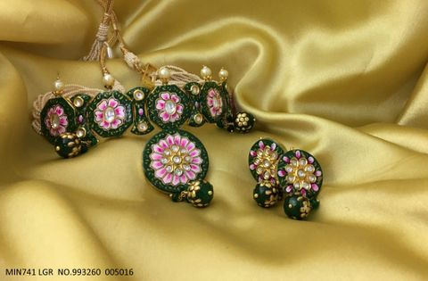 High quality Kundan Necklaces with Precious Stones - It is paired with couple of earrings