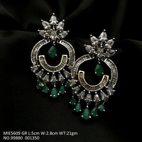 American Diamond earrings with an year warranty - Length is 5.0 cms , width is 2.8 cms , and weight is 21.0 grams