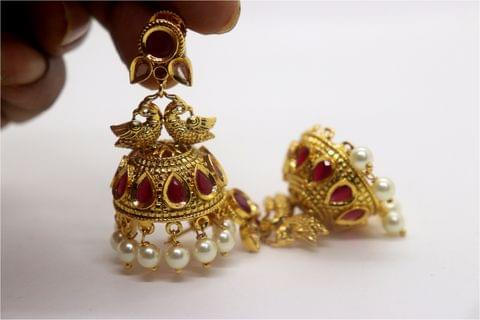Gold plated earrings studded with precious stones