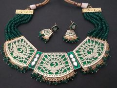 Awesome Peacock Designed necklace studded with kundan stones and with chain of precious pearl and beads.