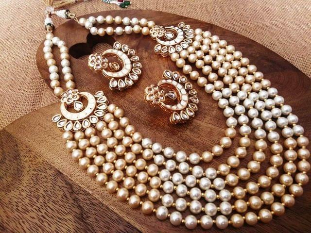Fresh Water Pearl necklace with pair of beautiful Jhumki studded with Kundan Stones