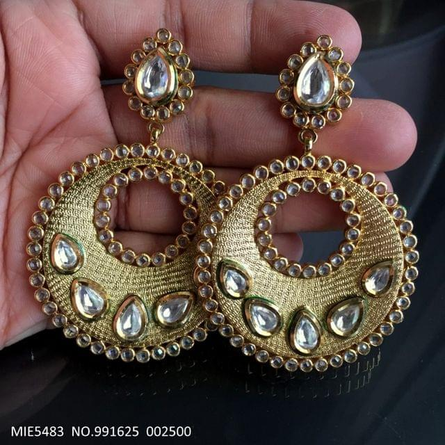 Brass + Gold plated dangler studded with Kundan and american diamond stones