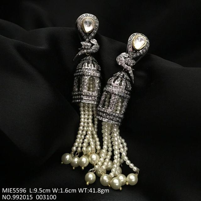 American diamond dangler with 1 year warranty. It is studded with Kundan Stones and Fresh Water pearls