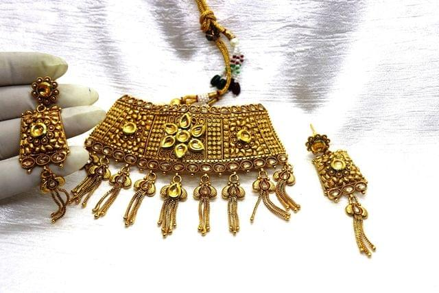 Gold Plated Necklace set studded with Kundan and semi precious Stones with an year warranty