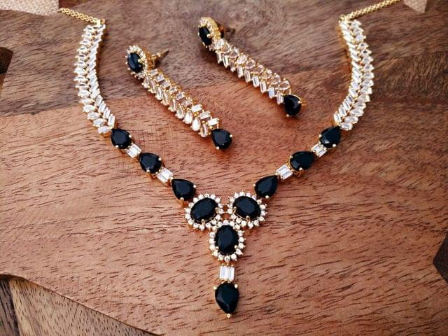 Beautiful blue colored American Diamond Necklace Set with an year warranty