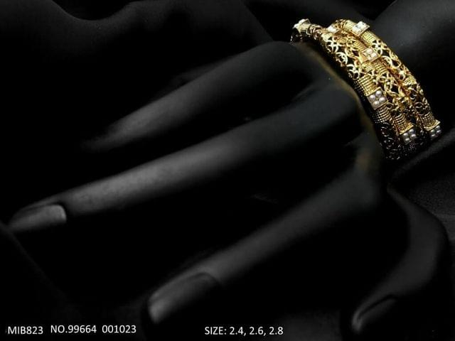American Diamond Bangles with an year warranty