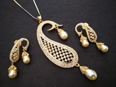 Gold plated plus American Diamond Pendant Set with an year warranty