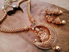 High quality gold plated Laxmi necklace set with an year warranty