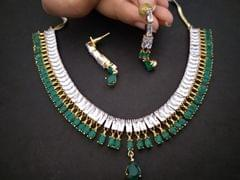 Beautifully designed Green Coloured American Diamond Necklace set coupled with beautiful pair of earrings .